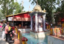 Devotees paying obeisance at Mata Kheer Bhawani temple at Tulamulla in Ganderbal on Friday. -Excelsior/Shakeel