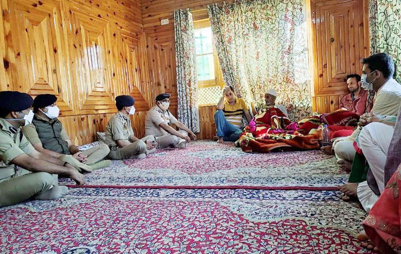 DGP Dilbag Singh alongwith DIG Vijay Kumar, DIG Central Kashmir Range Amit Kumar and SSP Srinagar Sandeep during a visit to the family of martyred Inspector Parvaiz Ahmad Dar. (UNI)