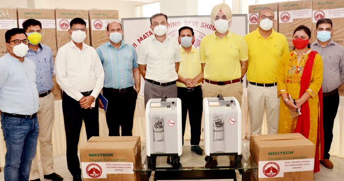 Chief Executive Officer, SMVD Shrine Board handing over Oxygen Concentrators to DC Reasi.