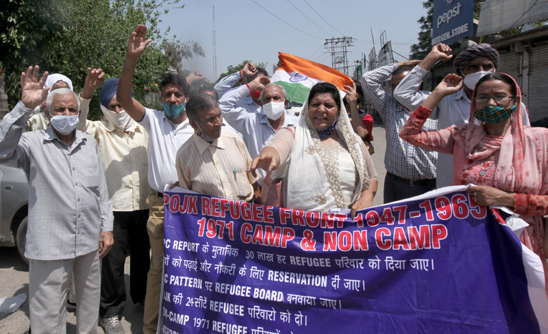 DPs from PoJK staging protest demonstration near Press Club in Jammu on Tuesday. -Excelsior/ Rakesh