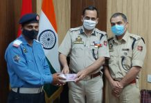 SSP Traffic Dr Koshal Kumar Sharma handing over cash to SPO Tarsem Lal.