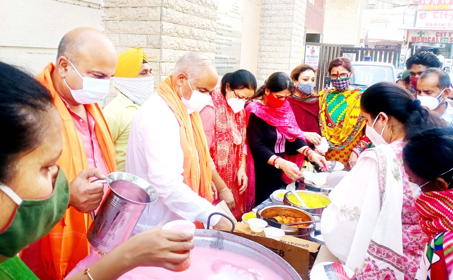 BJP leaders distributing food in front of GMC, Jammu to needy on Thursday.