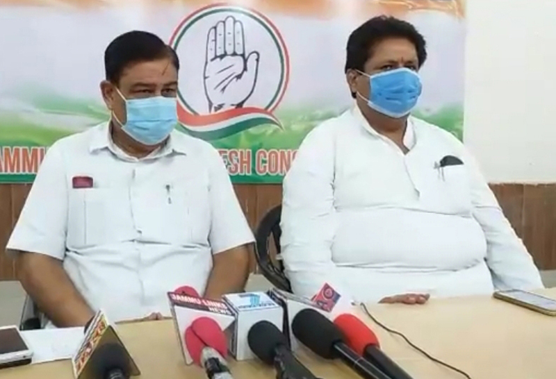 Senior Cong leaders Raman Bhalla and Ravinder Sharma addressing press conference in Jammu on Wednesday.