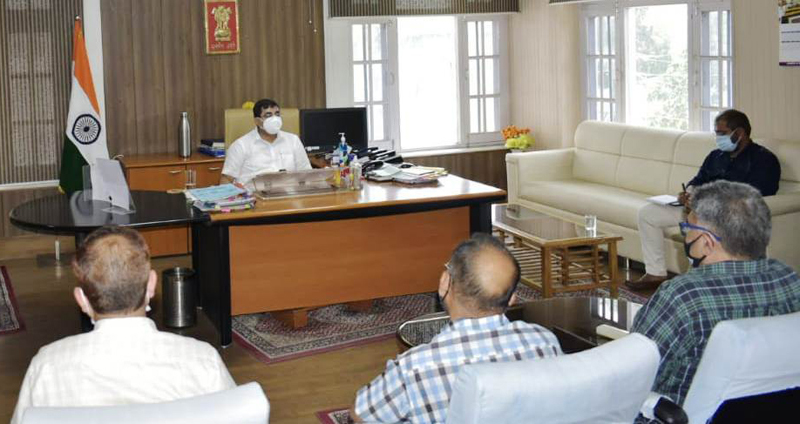 DC Rajouri, Rajesh Shavan chairing a meeting on Sunday.