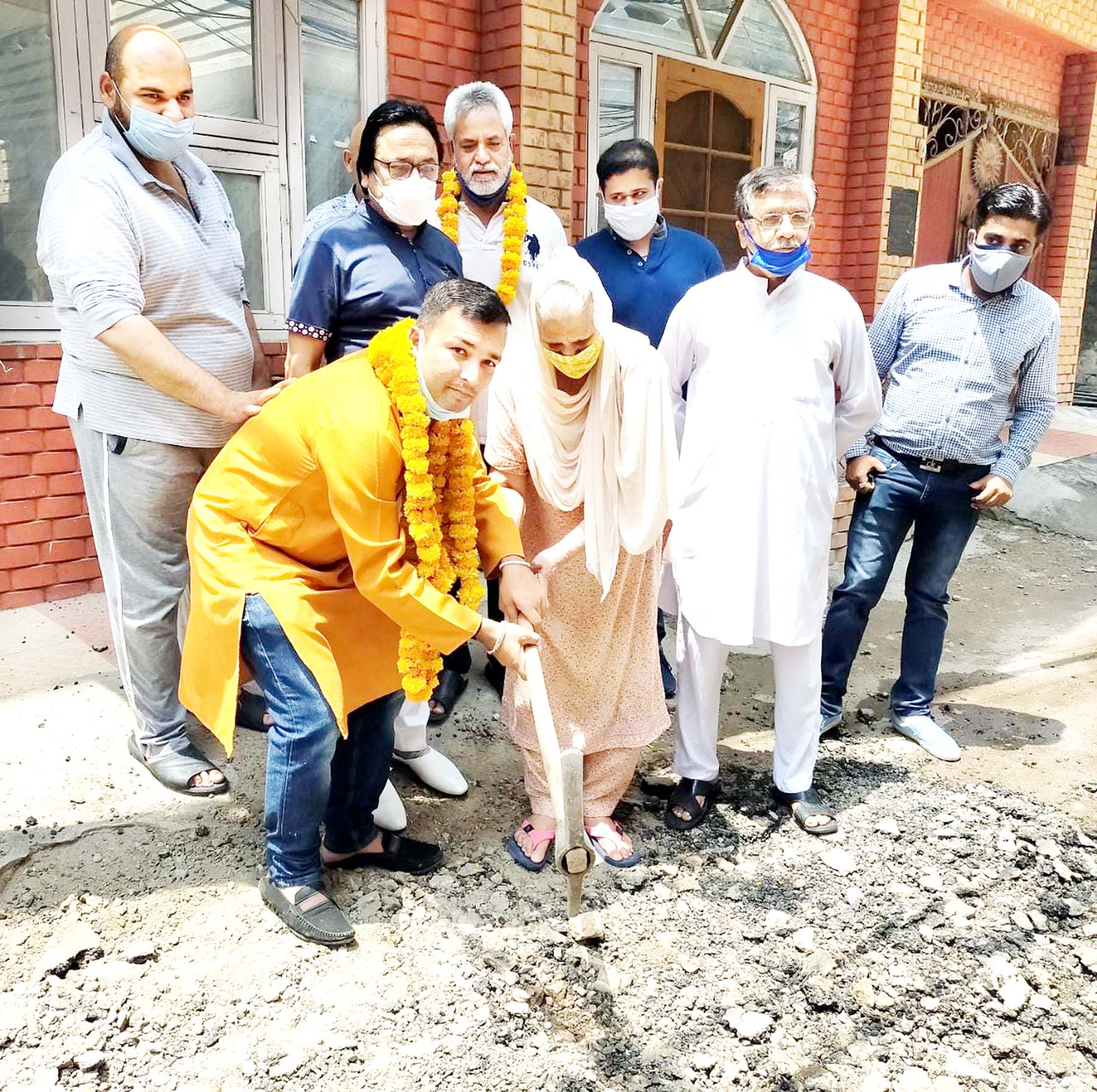 Councillor Amit Gupta starting tile works in Ward 19 on Monday.