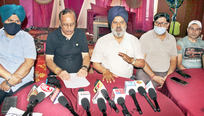Erstwhile wine traders addressing a press conference at Jammu on Wednesday. -Excelsior/Rakesh