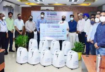 Officials of POWERGRID handing over oxygen concentrators to officials of District Administration, Jammu.