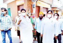 Congress leader Raman Bhalla interacting with locals during his visit to Preet Nagar Jammu.