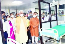 Lieutenant Governor Manoj Sinha taking round of GMC Hospital after inaugurating its new Emergency Block in Jammu on Thursday.