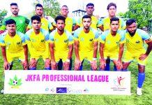 Winning team posing for a group photograph at Srinagar on Monday.