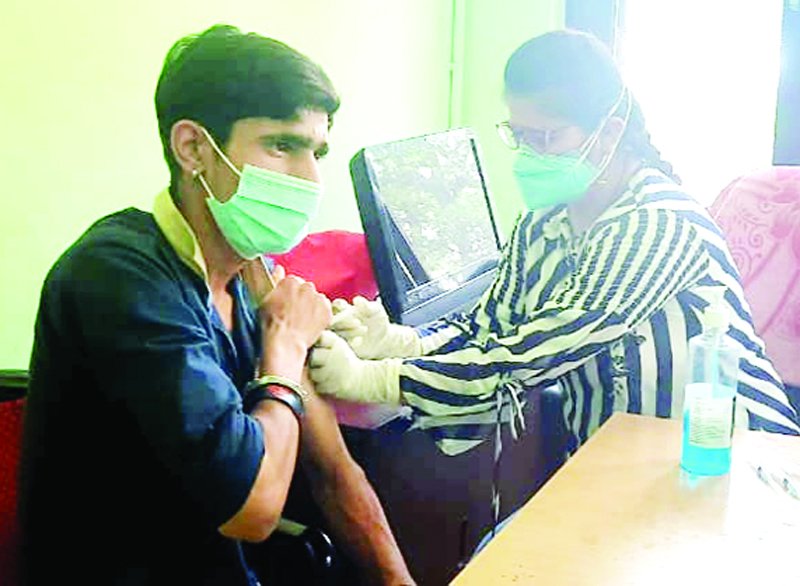 A young budding cricket player getting COVID dose during vaccination camp at Jammu.