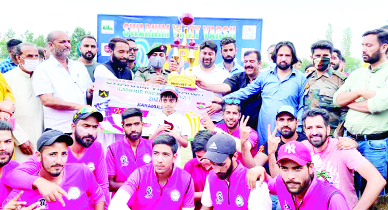 Winning team posing alongwith trophy and organisers of the tournament at Baramulla on Tuesday.