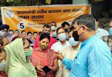 MP Jugal Kishore Sharma interacting with beneficiaries of Gareeb Kalyan Ann Yojna at Jammu on Sunday.