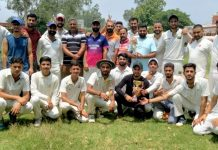 Players of Singh Cricket Club Akhnoor posing for group photograph in jubilant mood after winning Friendship Cup.