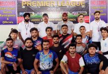 Winning team posing for a group photograph with dignitaries at Indoor Sports Complex Samba on Friday.