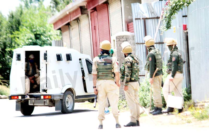 Security personnel during encounter at Hanjin Rajpora in Pulwama district on Friday. -Excelsior/Younis Khaliq