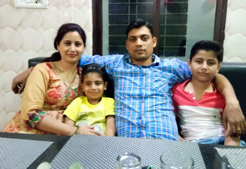 RPF officer Rakesh Kumar along with his wife and two sons.