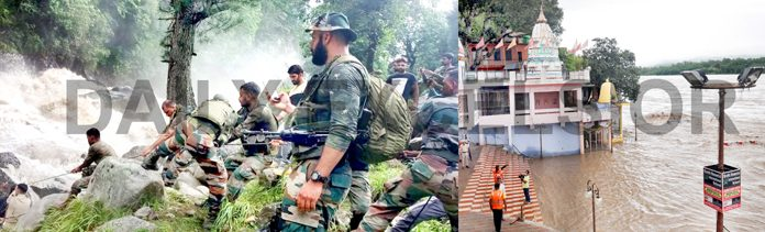 Army jawans assisting SDRF and police in rescue operation at village Honzar in Kishtwar (left) and a portion of temple submerged in flooded Chenab river at Akhnoor on Wednesday (right). -Excelsior pics by Tilak Raj & Rakesh