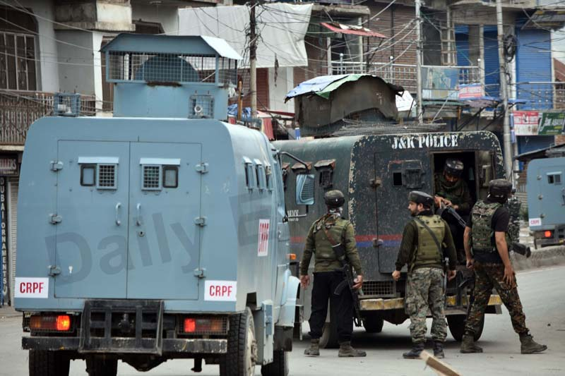 Security forces near encounter site at New Colony in Pulwama on Wednesday. -Excelsior/Younis Khaliq