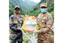Indo-Pak Army officials exchange sweets along LoC in Kashmir on Wednesday.