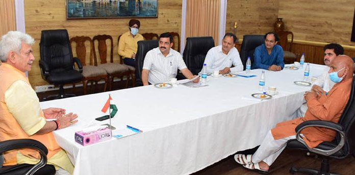 Lieutenant Governor Manoj Sinha interacting with visiting delegation of DDC Chairpersons at Jammu on Thursday.