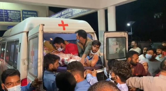Injured wife and daughter of cop being shifted to hospital in Anantnag on Tuesday. -Excelsior/Sajad Dar