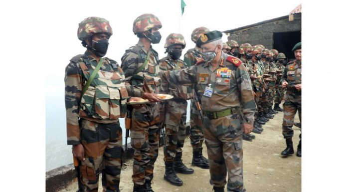 CDS Bipin Rawat interacting with troops during his visit to Kupwara sector along LoC on Tuesday.