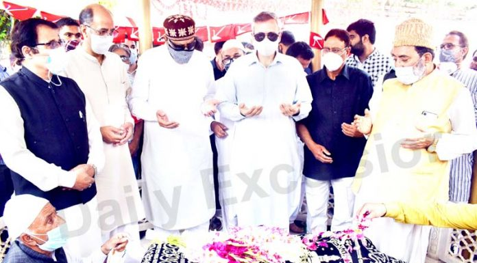 National Conference president Dr Farooq Abdullah, Omar Abdullah and other party leaders offer special prayers for Begum Akbar Jehan on her death anniversary at Hazratbal in Srinagar on Sunday. -Excelsior/Shakeel