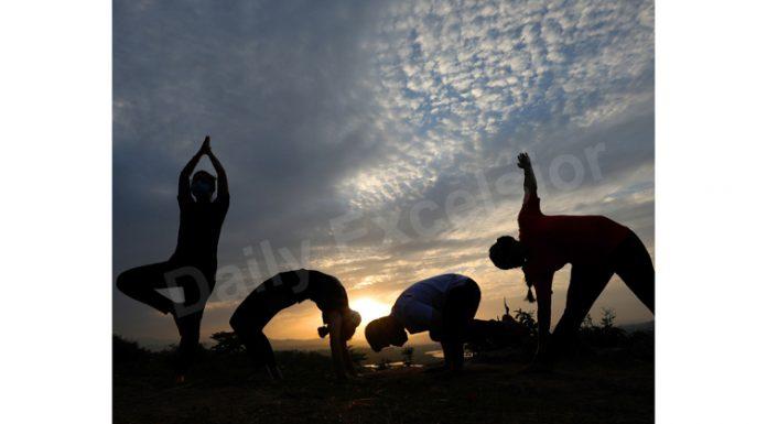 Yoga at Sunrise. — Excelsior/Rakesh