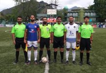 Captains alongwith referees posing for a group photograph before match at Srinagar on Wednesday.