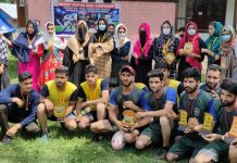 Winners and dignitaries posing for a group photograph at Shopian.
