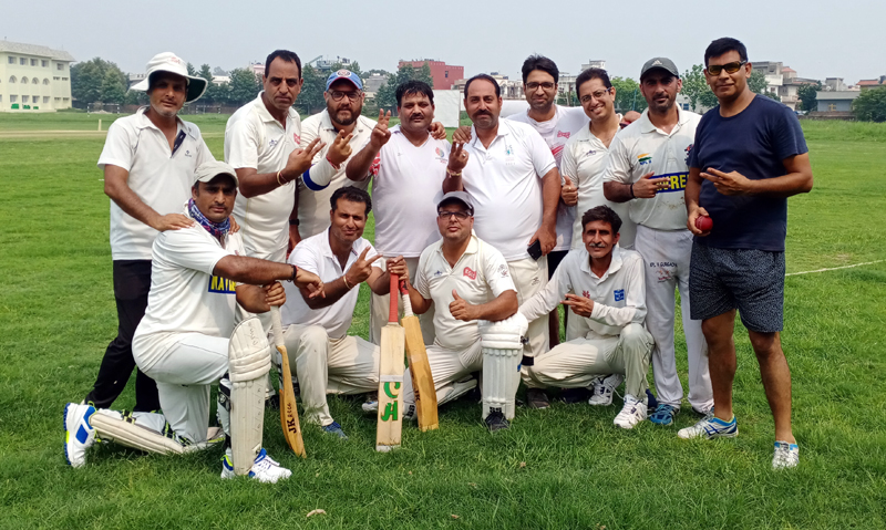Winning team posing for a group photograph at KC Sports Ground Jammu.