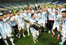Argentina players celebrating victory with Messi holding winning trophy of Copa America on Sunday.