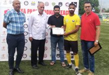 A player being awarded during the Professional Football League by dignitaries at Srinagar on Monday.