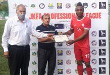 Dignitaries presenting man of the match award to Macdonald of Shaheen FC at Srinagar.
