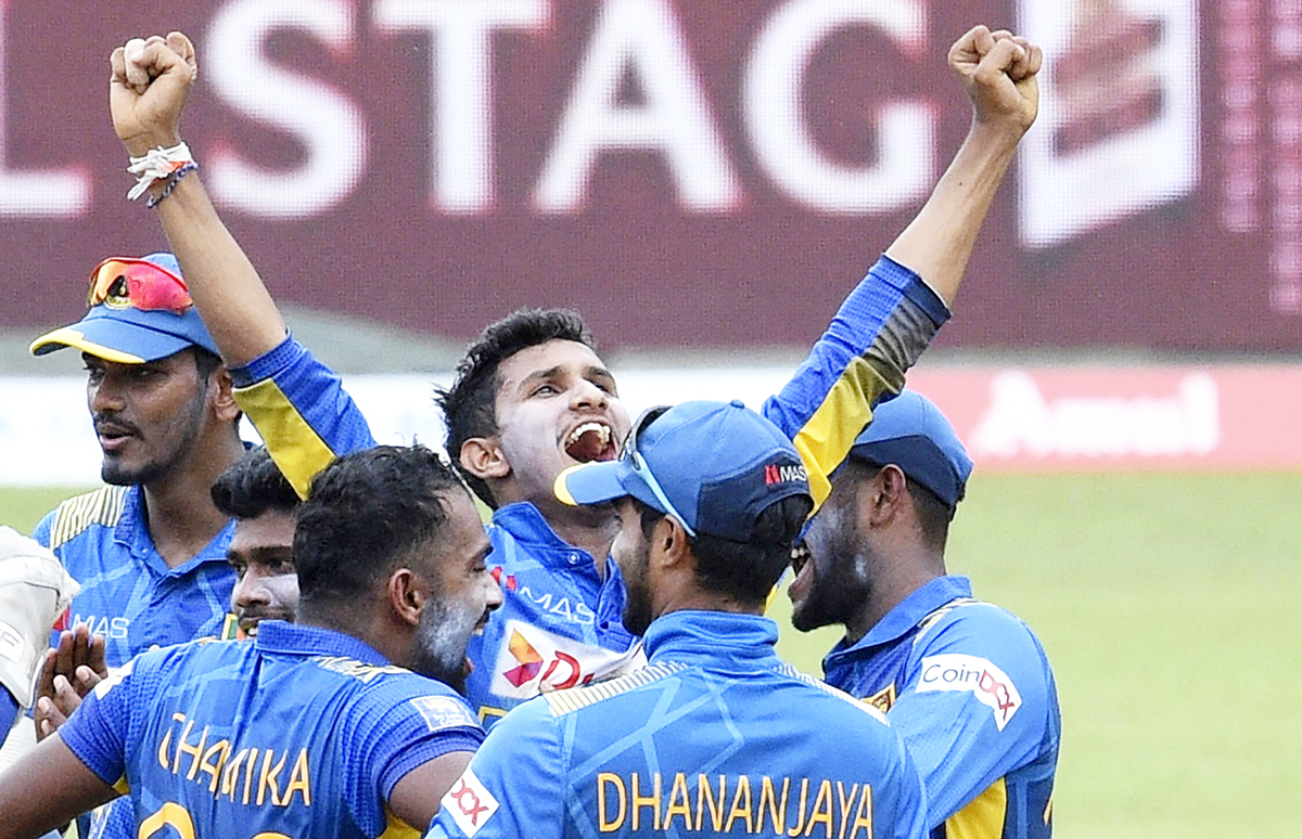 Sri Lankan players celebrating a wicket against India during third and final ODI at Colombo on Friday.