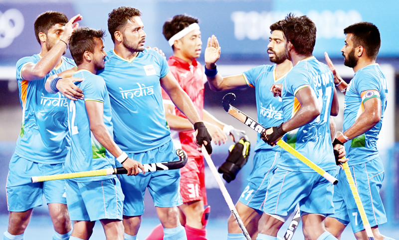 India hockey team celebrating victory over Japan during a match on Friday.