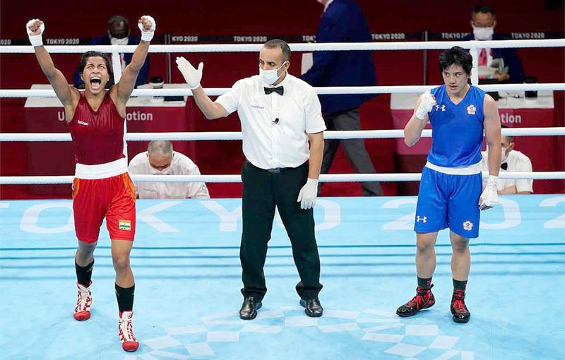 Lovlina Borgohain celebrating victory against Nien-Chin Chen of Chinese Taipei at Tokyo during Summer Olympics 2020 on Friday. (UNI )