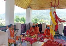 Mahant Deependra Giri Ji Maharaj along with Sadhus performing Puja at Pahalgam on Saturday.