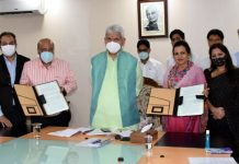 Lieutenant Governor, Manoj Sinha during the signing of MoU between J&K Floriculture Department & JSW Foundation on Wednesday.