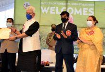 LG Manoj Sinha handing over cheque to an awardee at SKUAST-K Campus, Ganderbal on Saturday.