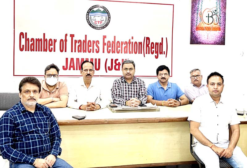 CTF president Neeraj Anand flanked by others at a meeting in Jammu.