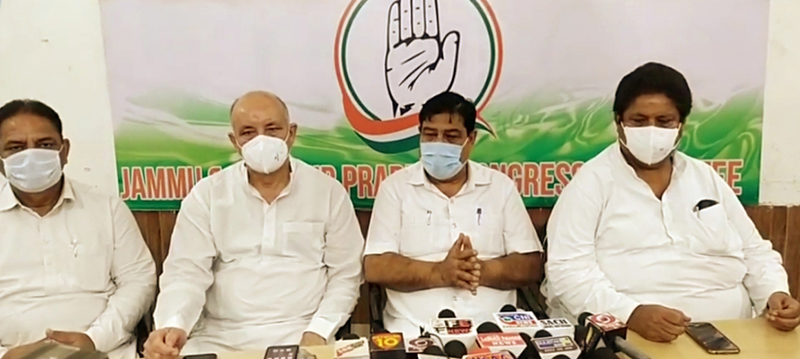 PCC chief spokesperson Ravinder Sharma flanked by other senior leaders addressing press conference in Jammu on Wednesday.