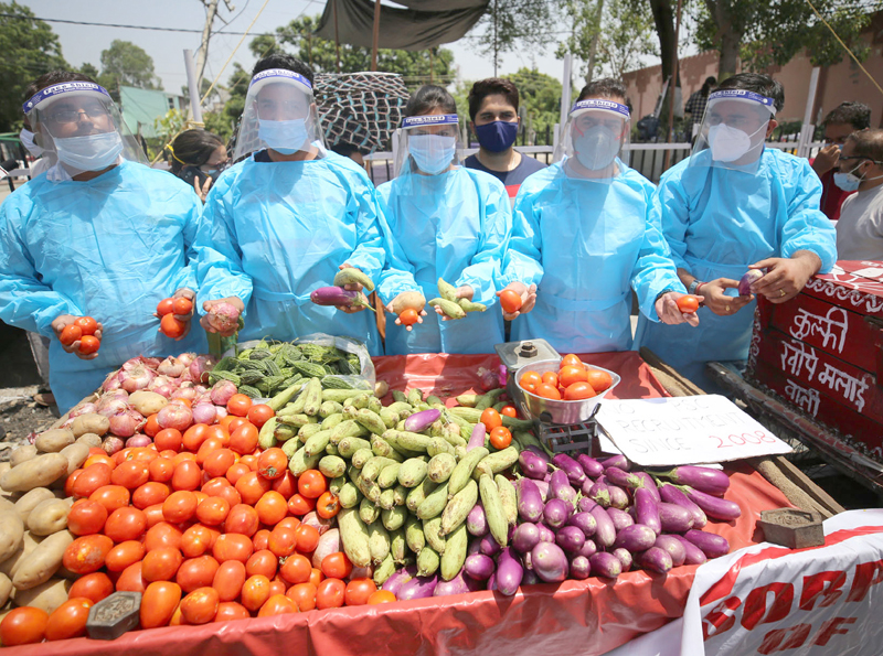 Unemployed dental surgeons selling vegetables as a mark of protest in Jammu. —Excelsior/Rakesh