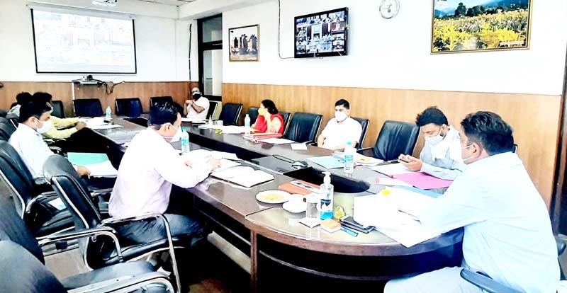 Div Com Jammu Dr Raghav Langer chairing a meeting on Monday.