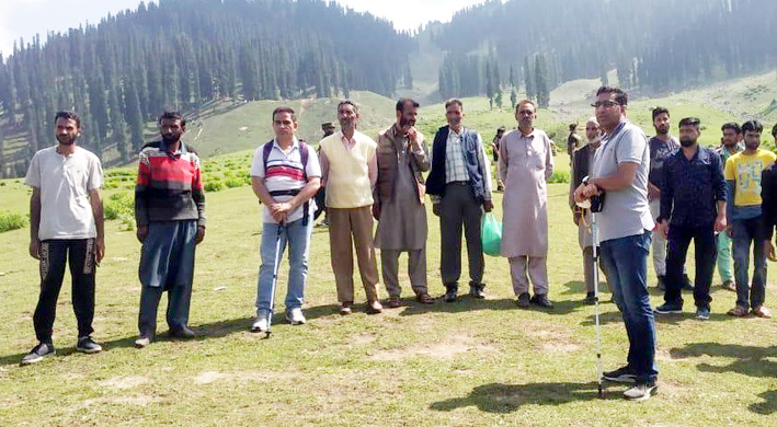 Secy Tribal Affairs Deptt Dr Shahid Iqbal Choudhary interacting with tribes at a highland pasture of Kupwara.