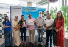Dignitaries awarding a participant of online summer camp.