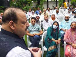 NC provincial president Devender Singh Rana interacting with a delegation.