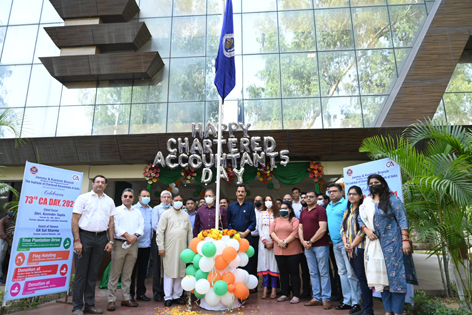 Members and office bearers of J&K Branch of ICAI performing flag hoisting ceremoney on CA Day at Jammu.