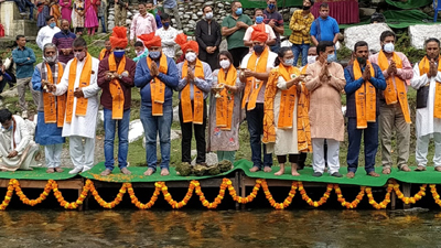 Director Tourism along with others performing rituals at bank of river Tawi in Udhampur.